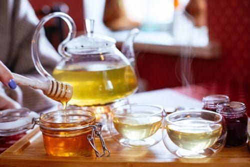 teapot and teacups with tea and honey on tray 1872886 scaled e1576538312259