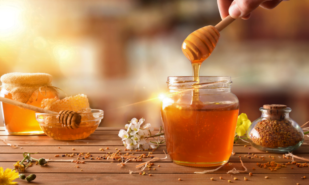 Honey being drizzled into a pot